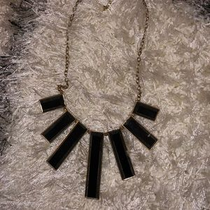 Black necklace with gold chain